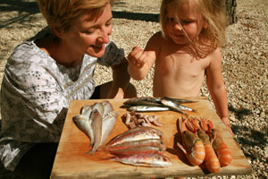 Cathy teaching Rosie about seafood.