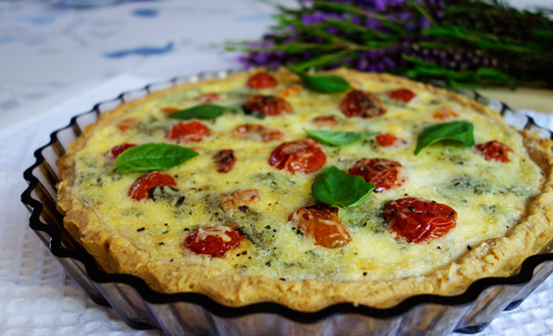 ROUX's Drunken Pecorino (Pecorino Ubriaco) quiche with roast tomatoes and Nudo's basil olive oil.
