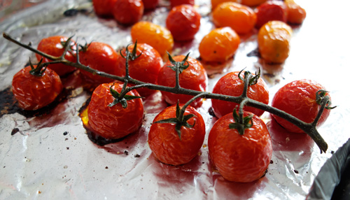 Roast cherry tomatoes on the vine.