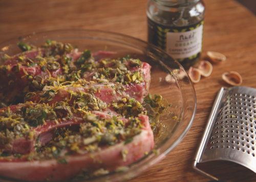 Lamb chops marinating in pistachio, mint olive oil, lemon juice, garlic and capers.