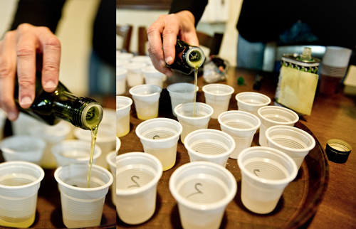 Pouring olive oil in little tasting cups